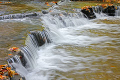Water cascades on a mountain river Stock Photo