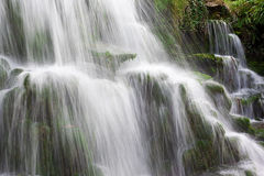Water Cascades Over Mossy Rocks Stock Photos