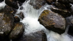 Water Cascades Over Rocks in Waterfall Stock Photography