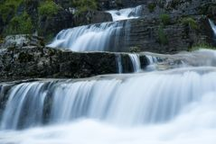 Water cascades on stones Stock Images
