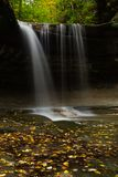Autumn in LaSalle Canyon. Water cascading down LaSalle Canyon on a Autumn/ Fall morning.  Starved Rock State Park, Illinois, USA Royalty Free Stock Photos