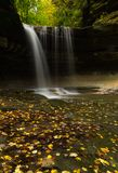 Autumn in LaSalle Canyon. Water cascading down LaSalle Canyon on a Autumn/ Fall morning.  Starved Rock State Park, Illinois, USA Royalty Free Stock Photography