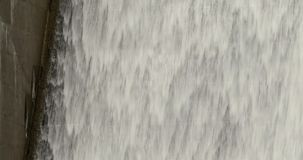 Water cascading down the spillway of a dam stock video footage
