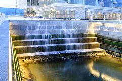 Tidal well South Boston. Water cascading down tiers in tidal well along Harborwalk in South Boston Stock Photos