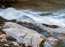 Water cascading over boulders. Stock Image