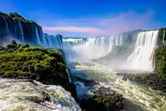 Water cascading over the Iguacu falls. In Brazil royalty free stock photo