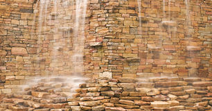 Water Cascading Over Stone Wall Stock Images