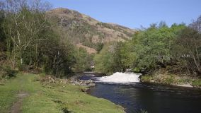 Water cascading into River Leven Kinlochmore near Kinlochleven Scotland UK in summer stock footage