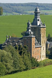 Water Castle Beusdael in hilly landscape, Belgium Royalty Free Stock Photography