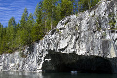 Water cave in the rock. Stock Photos