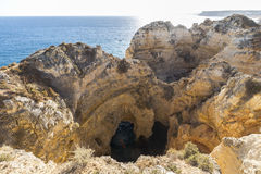 Water caves in rock formation of Lagos, Algarve, Portugal Stock Images