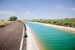Water channel. Landscape with road and water channel royalty free stock images