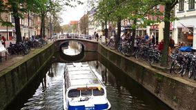 Water channel in the city from under the bridge comes up tourist ship stock footage