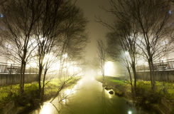 Water channel at night Stock Images