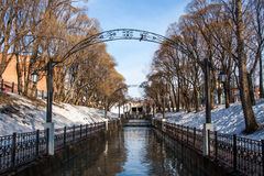 The water channel in park a spring sunny day Royalty Free Stock Image