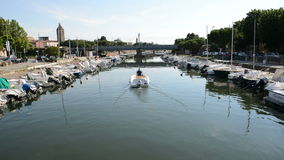 The water channel with parked motor boats. Rimini, Italy stock video