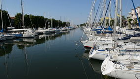 The water channel with parked sail yachts. Rimini, Italy stock video