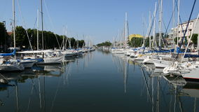 The water channel with parked sail yachts. Rimini, Italy stock video footage