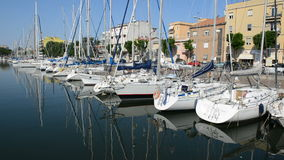The water channel with parked sail yachts. Rimini, Italy stock footage