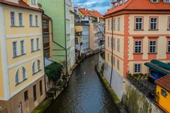 Water channel with river of Certovka Devil`s Channel, also called Little Prague Venice, in district of Lesser Town Mala Strana stock image