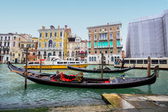 Water channell with gondolas in Venice Stock Images