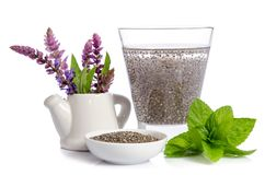 Water with chea seeds, mint leaves and salvia flowers Stock Image