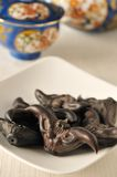 Water chestnuts or caltrops. On table royalty free stock images