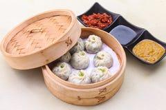 Water chestnuts & spinach dim sum. Oriental dish Water chestnuts & spinach dim sum royalty free stock images