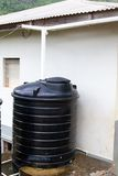 Water Cistern. Old water cistern collects rain water runoff through the roof downspout stock photography