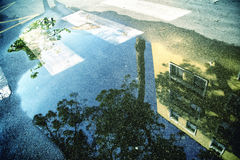 Water on city ashpalt floor with reflection Royalty Free Stock Images