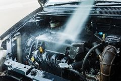 Water cleaning car engine. royalty free stock image