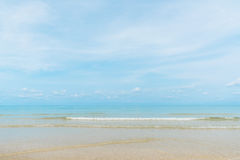 Water clear at the sandy beach. With blue sky royalty free stock photography