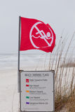 Water closed to public red flag flying on beach Royalty Free Stock Photography