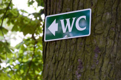 Water closet sign. Recorded in a typical german Biergarten in Bavaria Stock Images