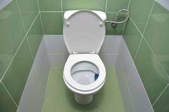 Water closet tiled by green material. Water closet tiled by fresh green material Stock Photography