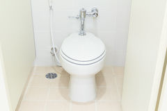 Water closet toilet. White water closet and tile floor in toilet room royalty free stock photography