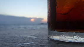 Water on cold water glass under sunset Stock Image