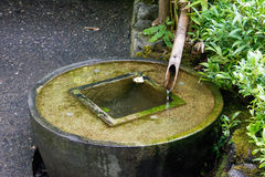 Water collection cistern. Using bamboo pipes at Butchart Gardens in Victoria, British Columbia, Canada stock image