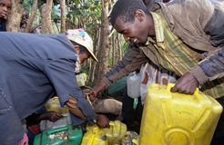 Water collection at a village, Uganda Royalty Free Stock Images