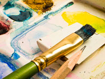 Water-color, brush and palette Royalty Free Stock Photos