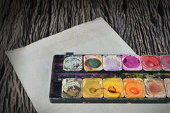 Water color paint box on dirty paper Royalty Free Stock Images
