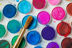 Water-color paint-box and paint brush. Royalty Free Stock Photo