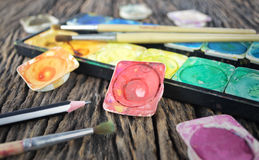 Water color paint box and paint brush Royalty Free Stock Photo