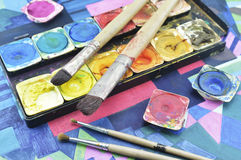 Water color paint box and paintbrush Stock Photos
