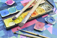 Water color paint box and paintbrush Royalty Free Stock Image