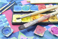 Water color paint box and paintbrush Royalty Free Stock Images