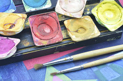 Water color paint box and paintbrush Royalty Free Stock Photography
