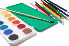 Water-color,paintbrush and color pencils Stock Images