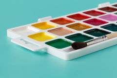 Water color paints with brushes Royalty Free Stock Photo