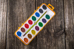 Water Color Paints on Vintage Wood Royalty Free Stock Photography